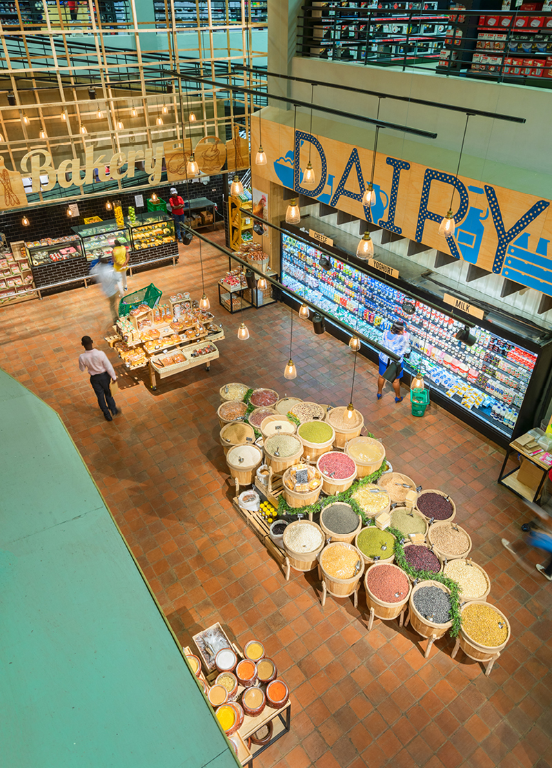supermarket overview with dairy products, spices and a bakery
