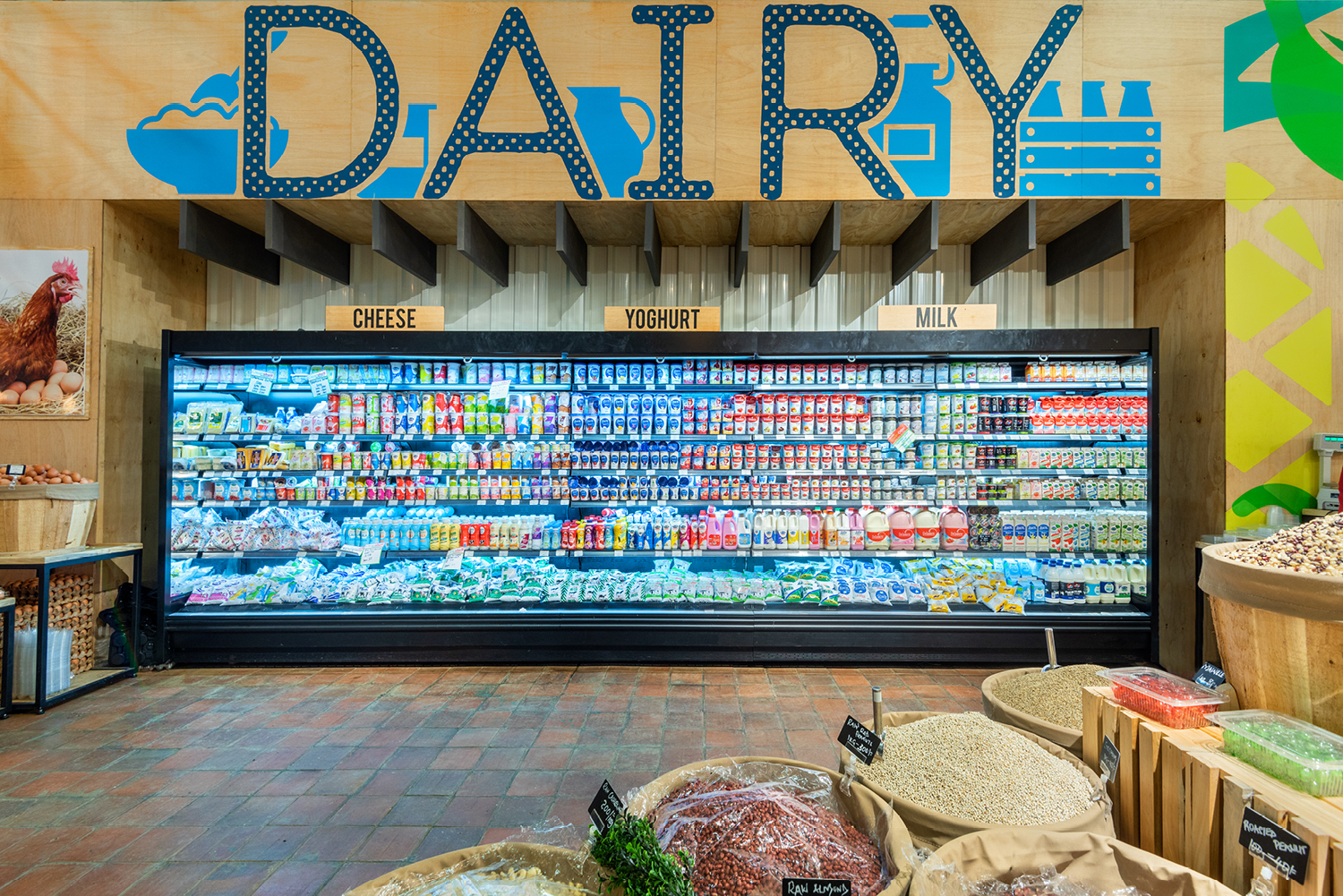 big supermarket fridge filled with dairy products