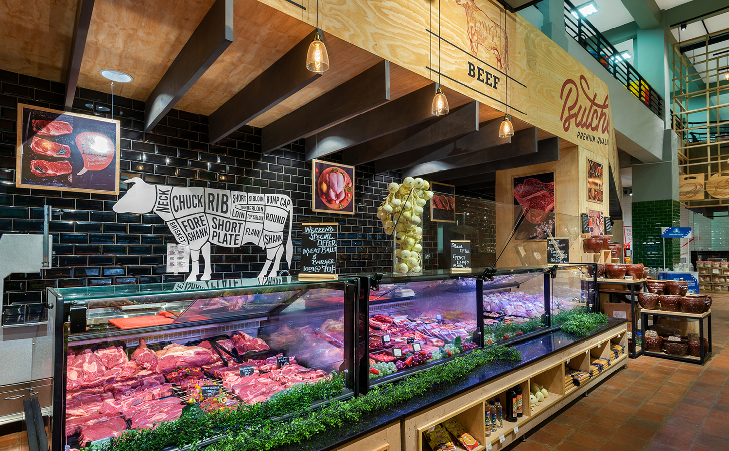butcher counter at supermarket displaying various type of red meat