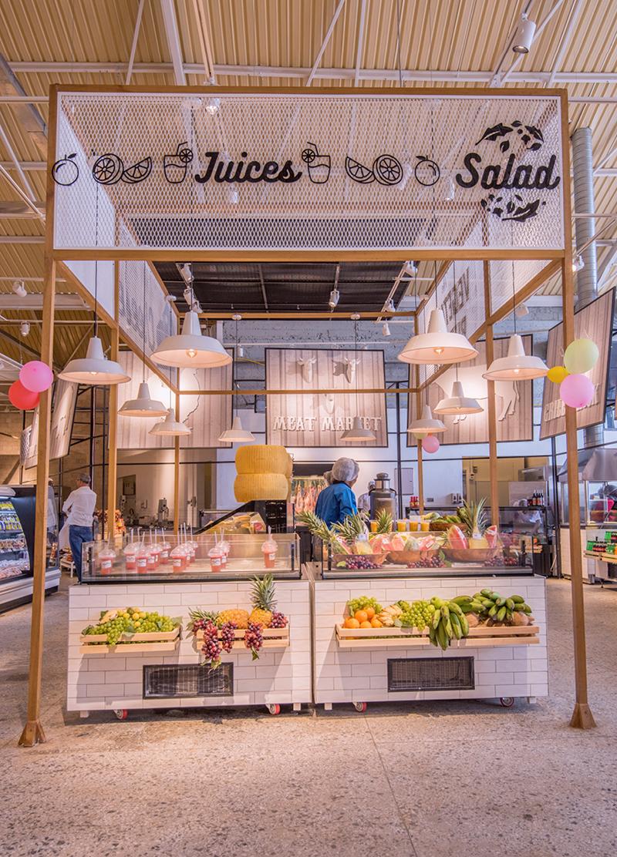 wooden salad bar inside a supermarket