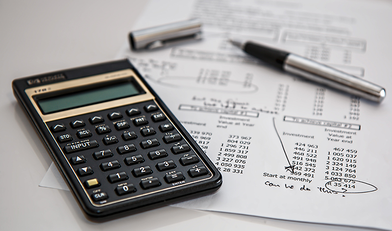 A calculator with invoices.