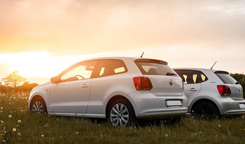 White vehicles at sunset