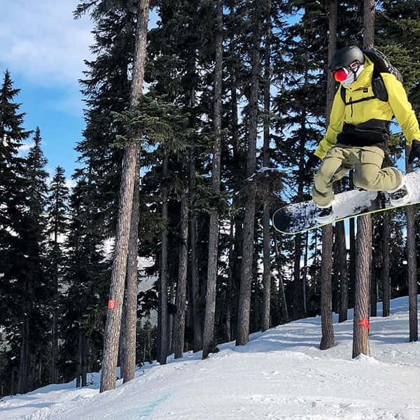 Bryn mid-air, snowboarding in Whistler
