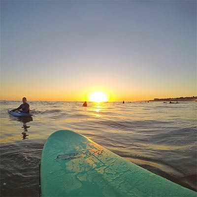Surfing into the sunset in Carcavelos, Portugal