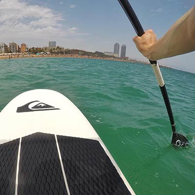 Paddleboarding off the beach of Barcelona