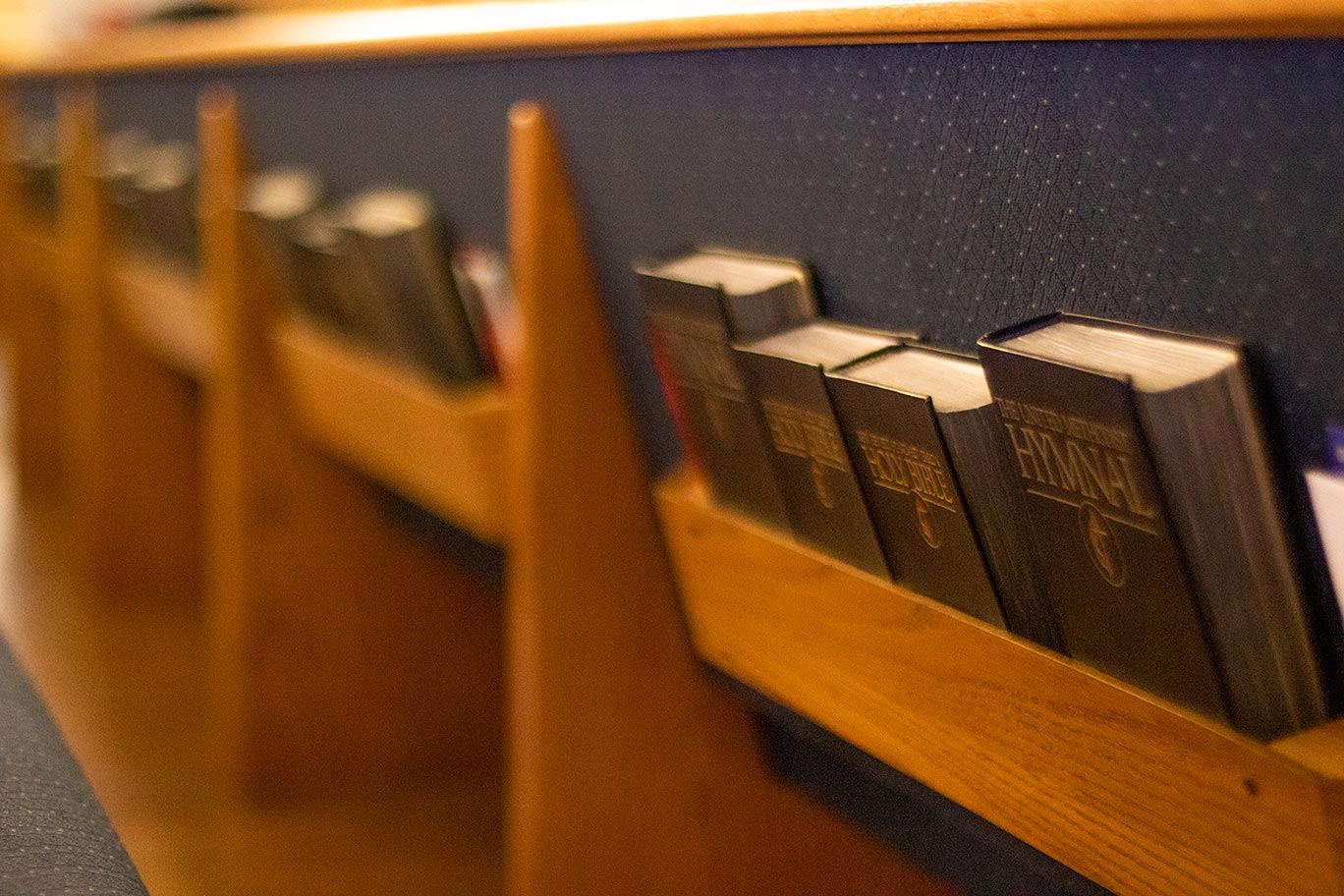 Bibles in the back of a pew.