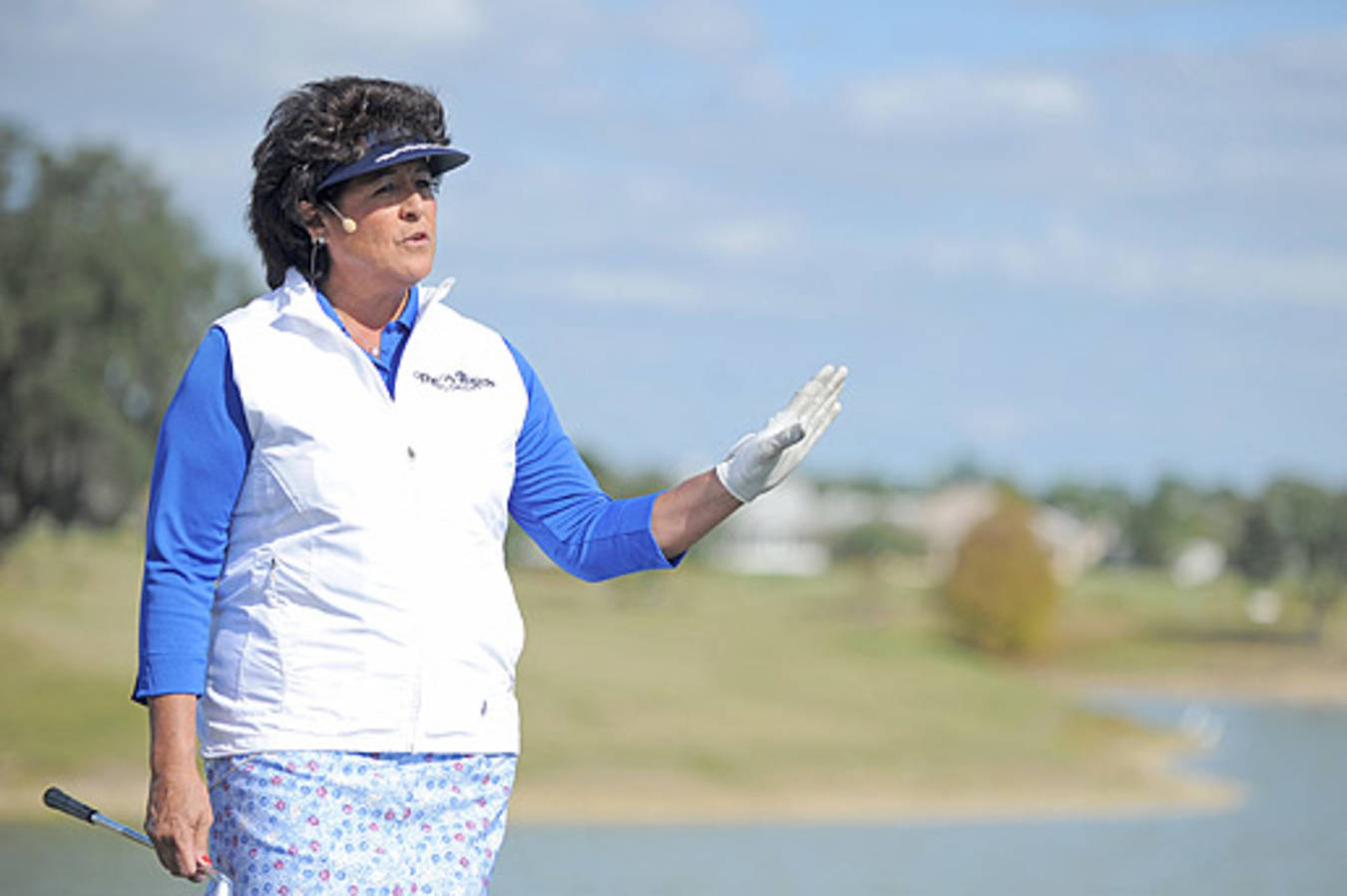 NANCY LOPEZ gives lesson on golf course