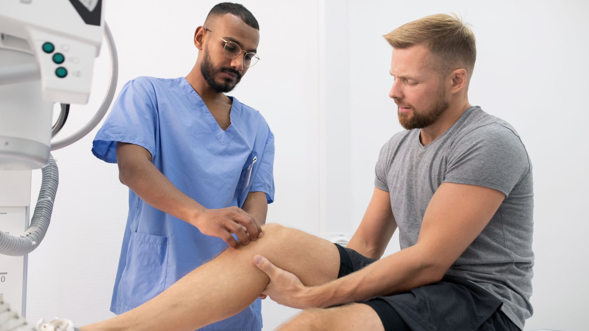Physician examining patients knee