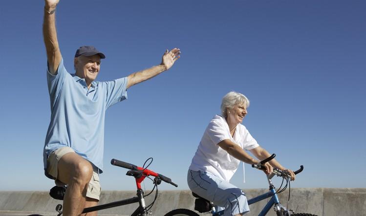 elderly couple riding bikes and enjoying active lifestyle