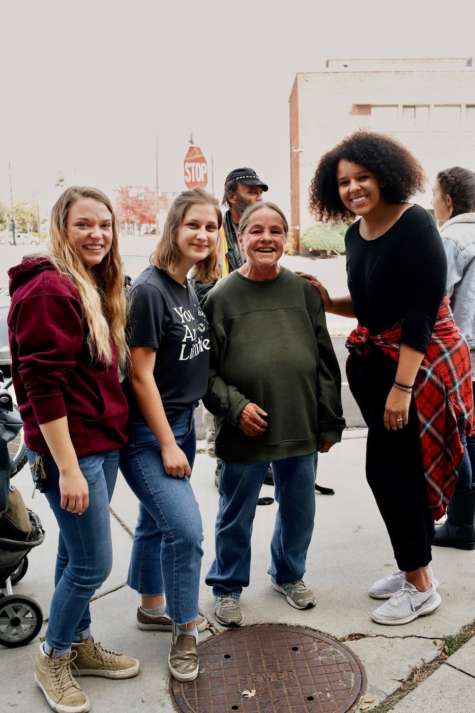 Neighbor Idaho volunteers with homeless woman