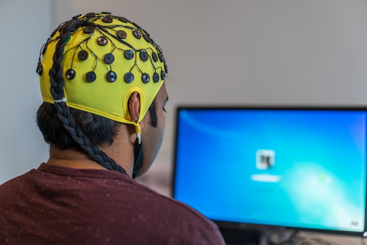 Man wearing common type of EEG headwear