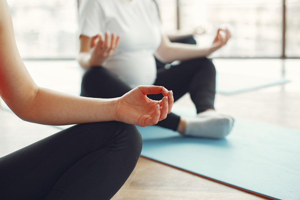 Thinking about meditation and seizures as women meditate in a class