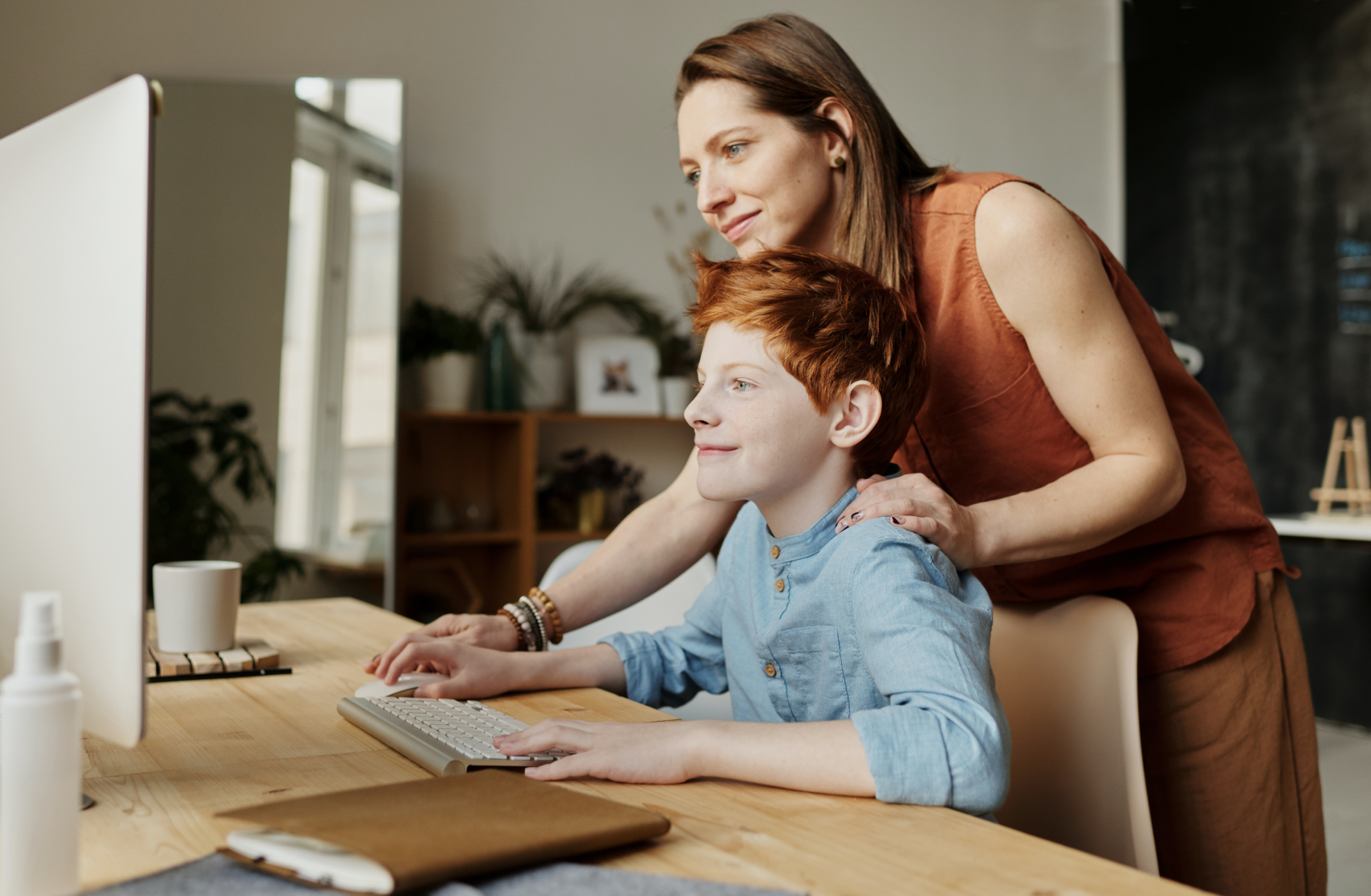 Mother and son learning what causes epilepsy in children together on a computer