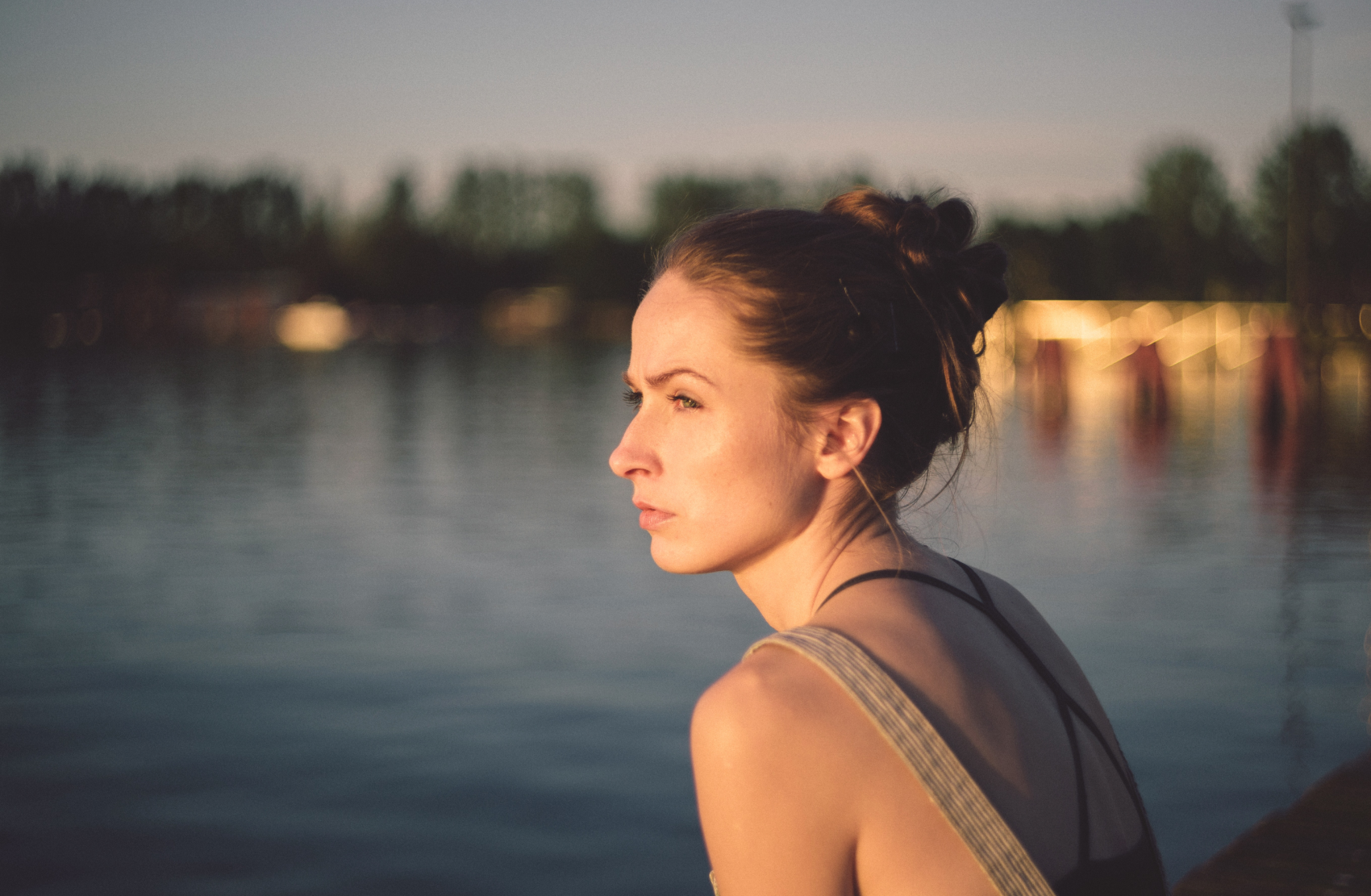 Woman sits by river with epilepsy and depression