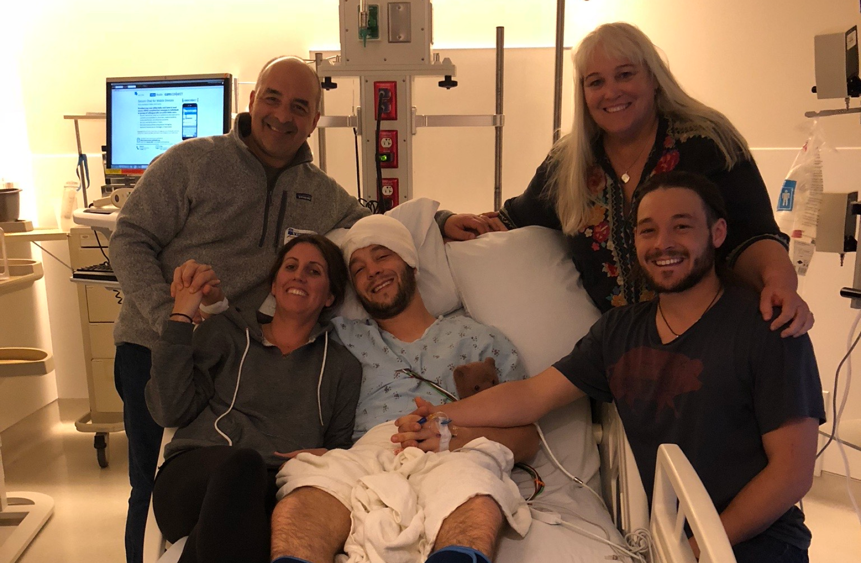 Jared Muscat and his family after brain surgery