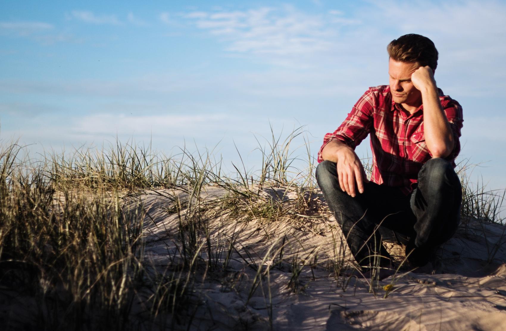 A man sitting with complex partial seizure symptoms