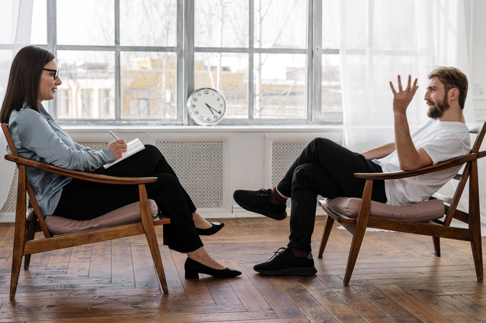 Therapist offering patient mental health tips