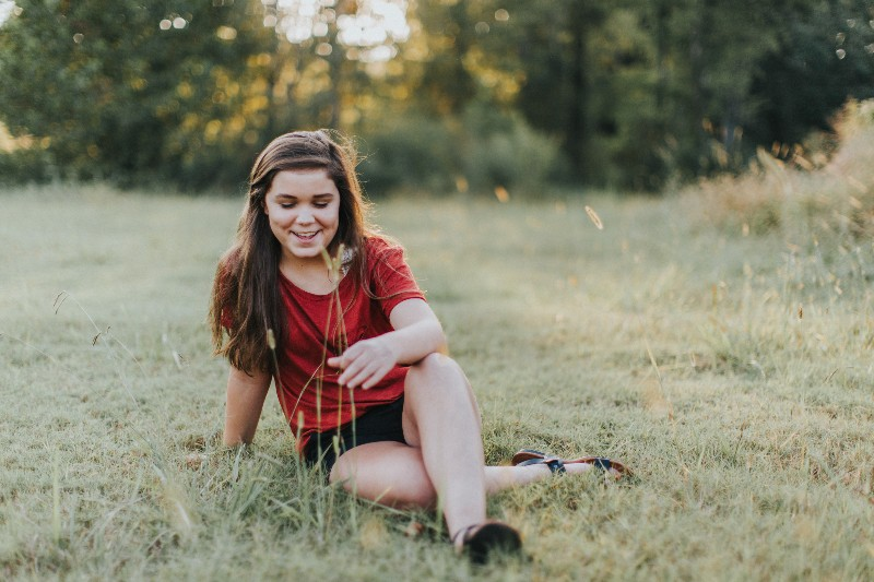 teenage girl in field