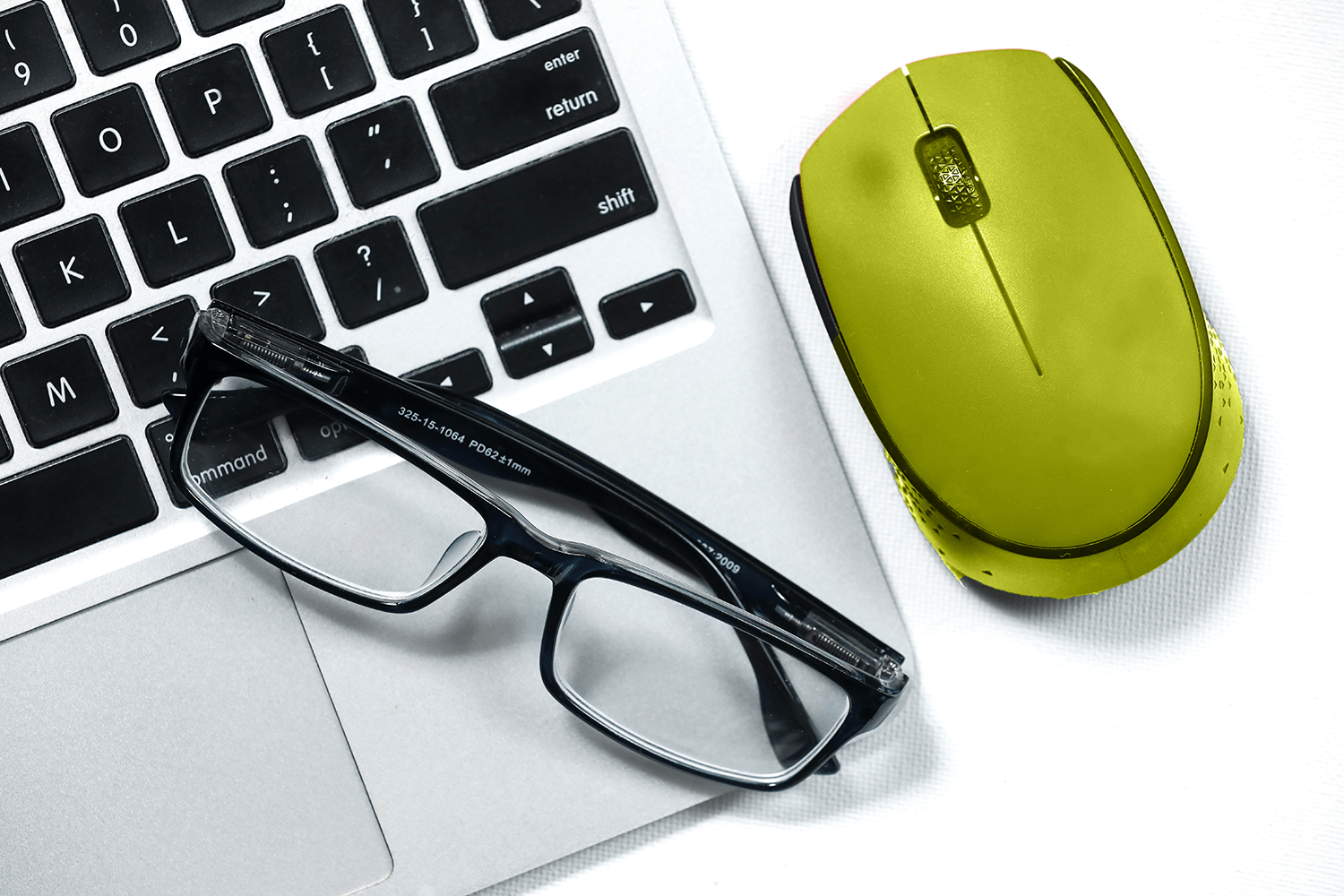 Photo of a laptop keyboard and mouse