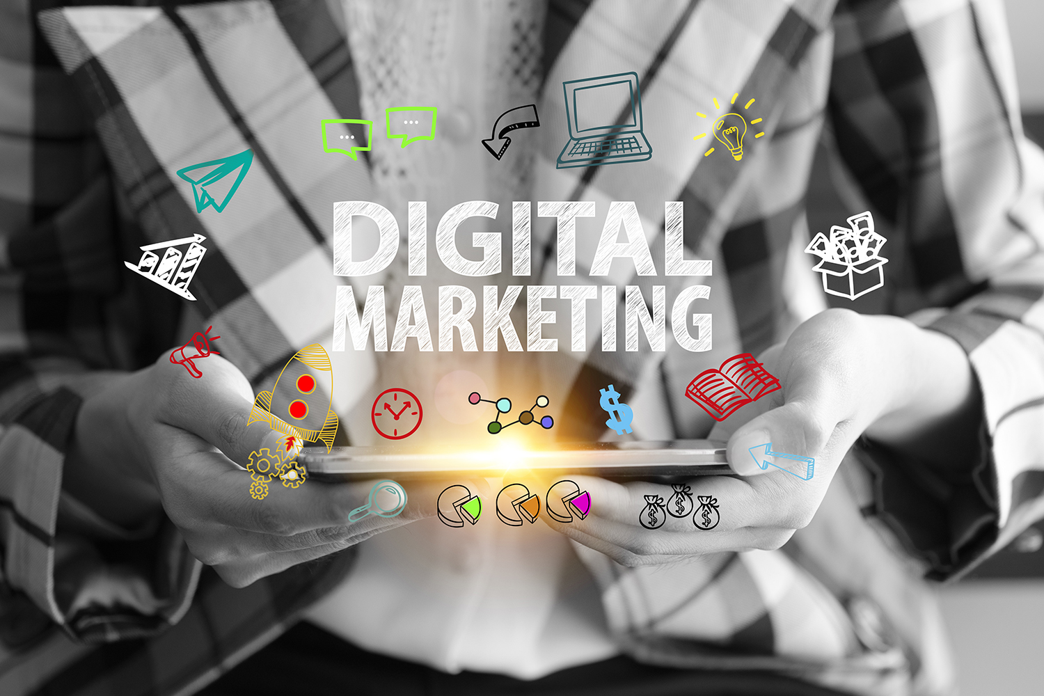 Image of a person holding an ipad with the text 'Digital Marketing' abovce and icons illustrating.