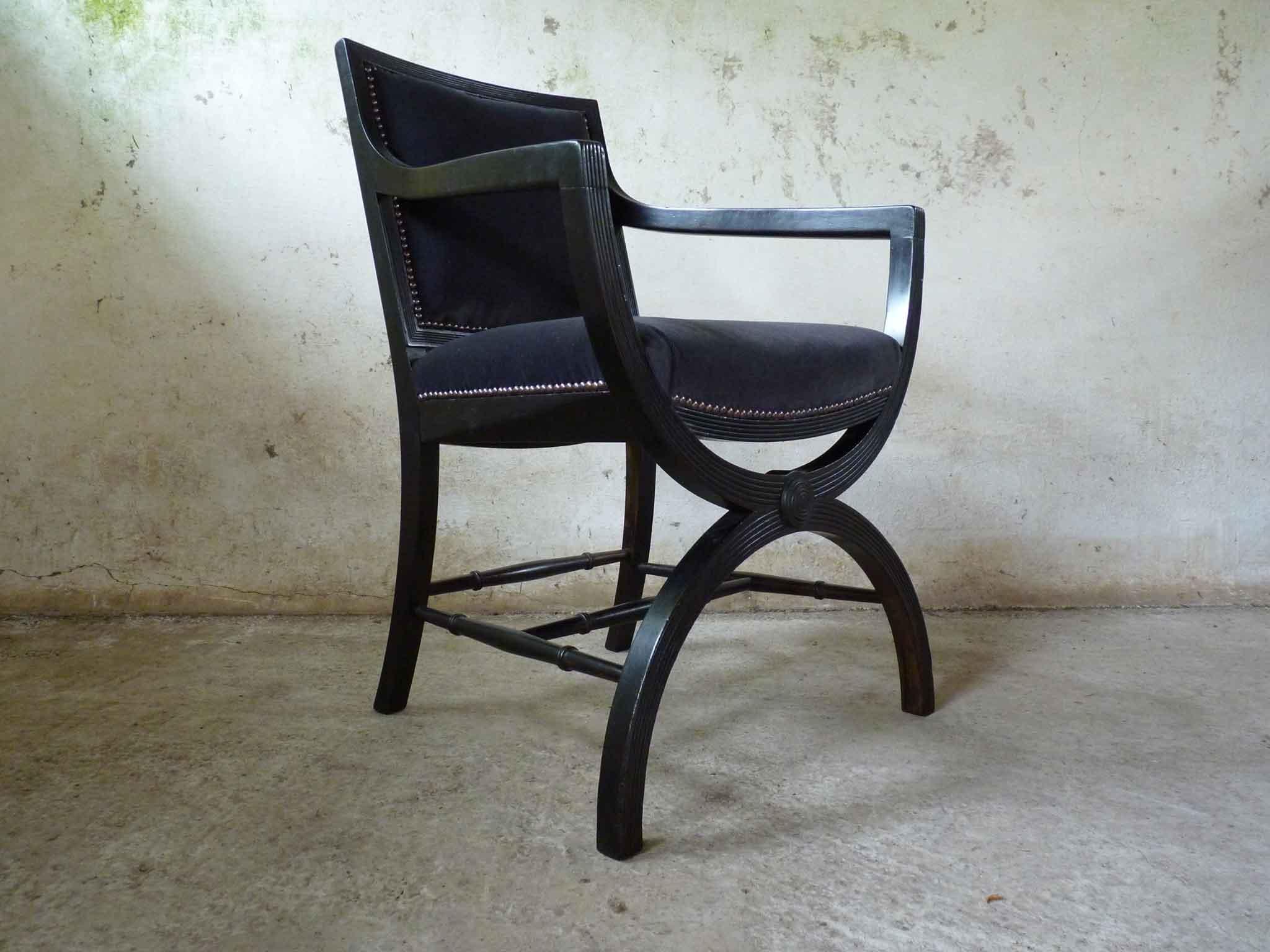 Ebonised X frame chair