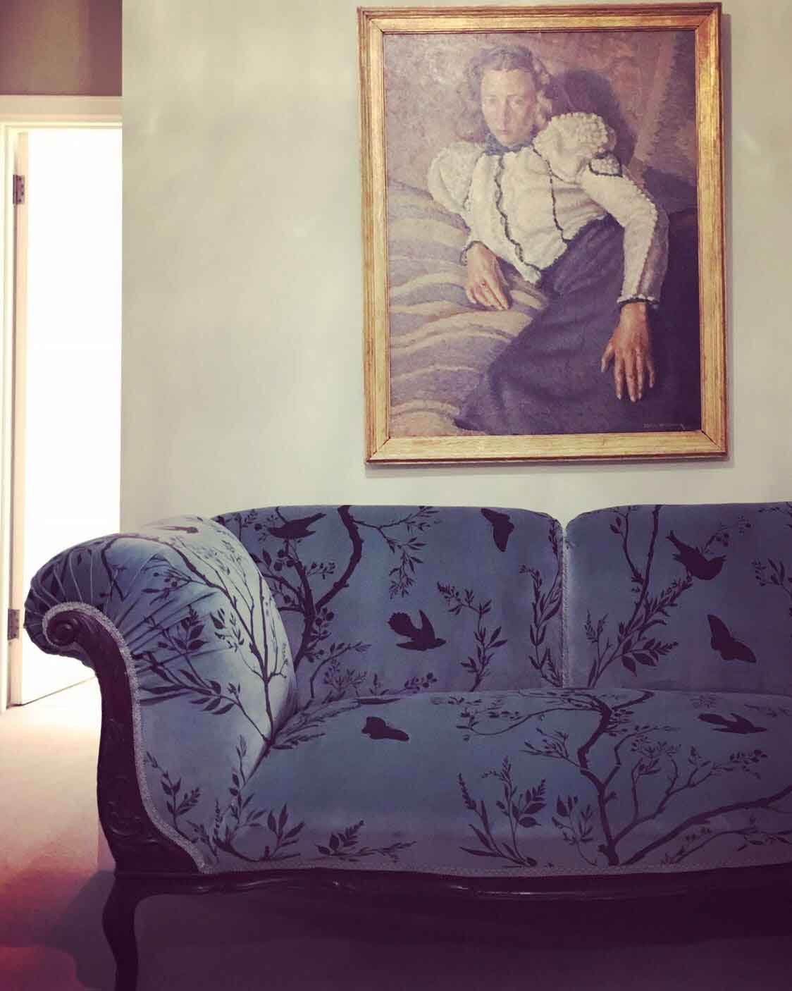 Antique sofa upholstered in bird branch velvet by timorous beasties