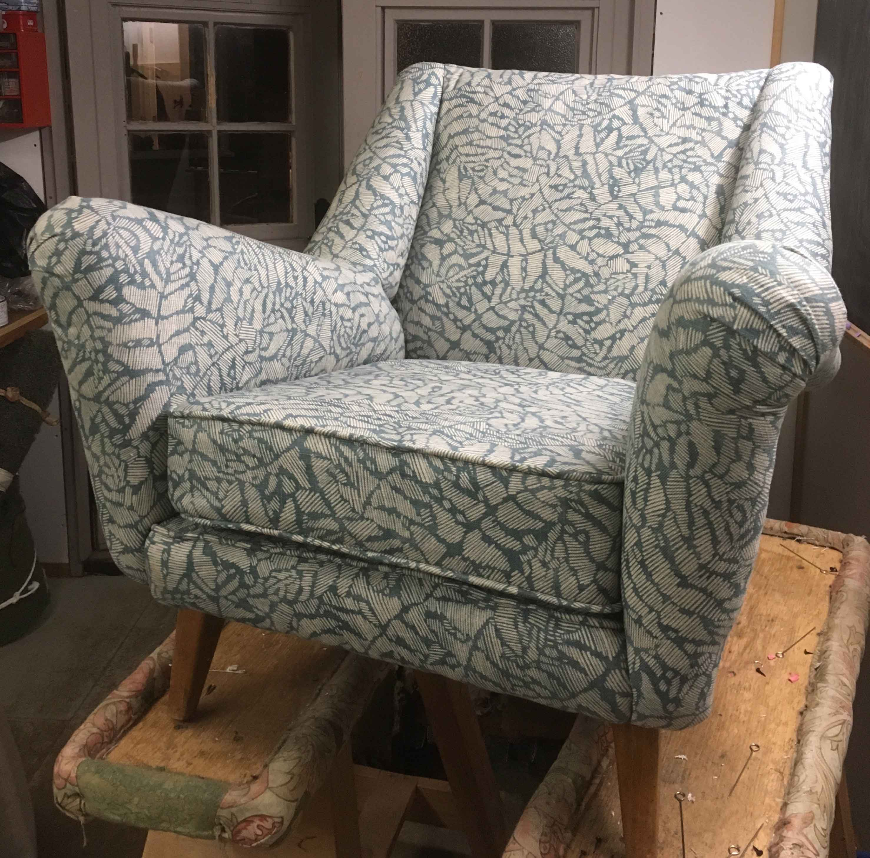 Atomic style mid century armchair upholstered in carnival fabric by Linwood