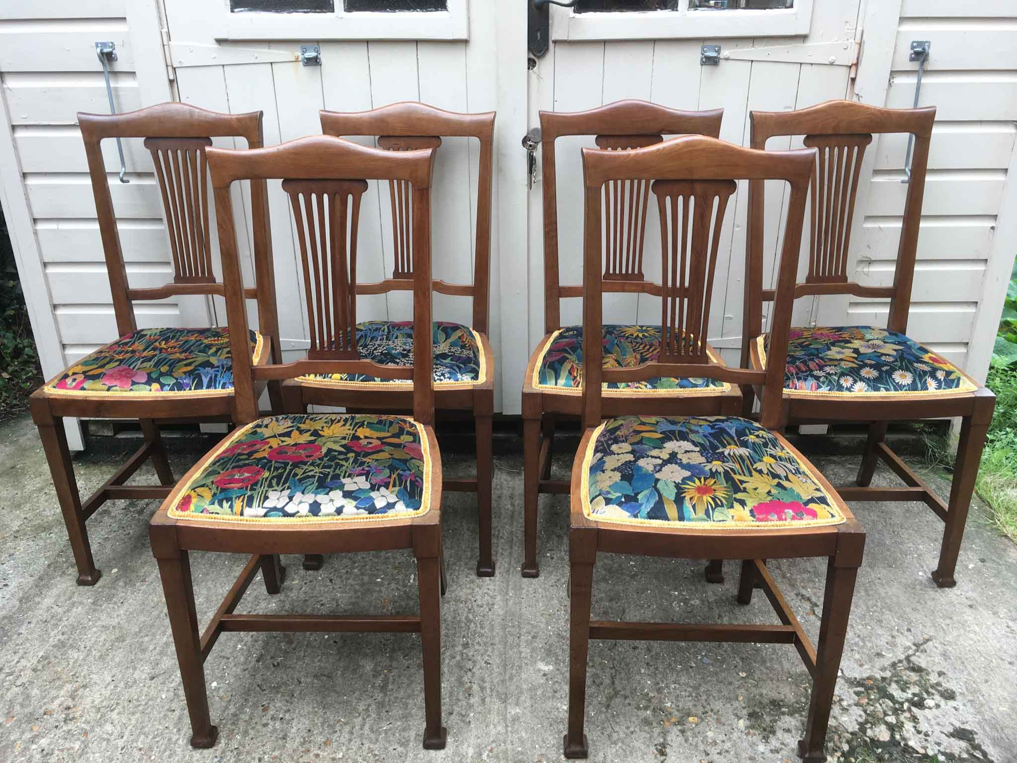 Edwardian dining chairs upholstered in faria flowers velvet by liberty