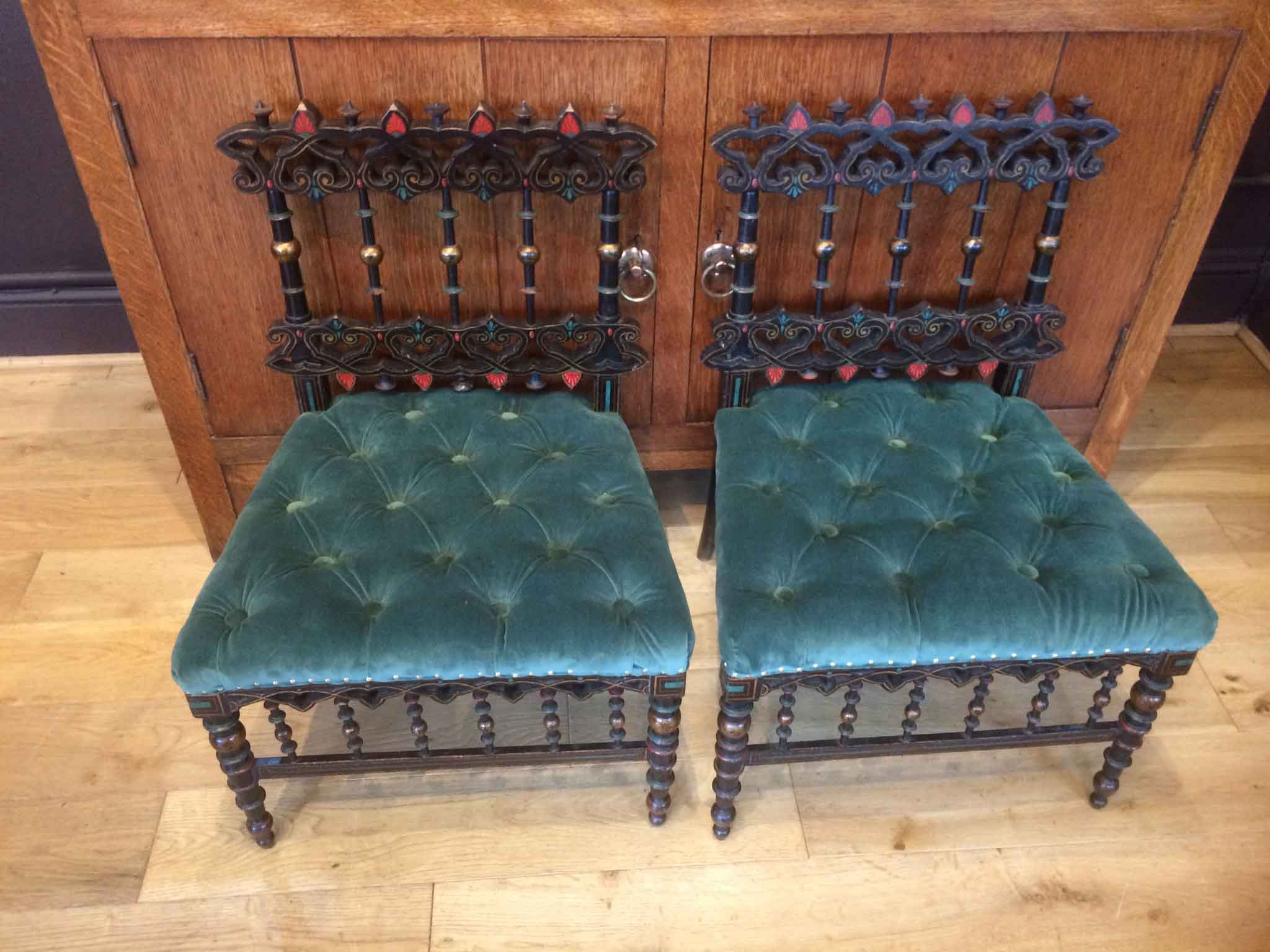Pair of Anglo Indian aesthetic movement chairs with buttoned seats in velvet