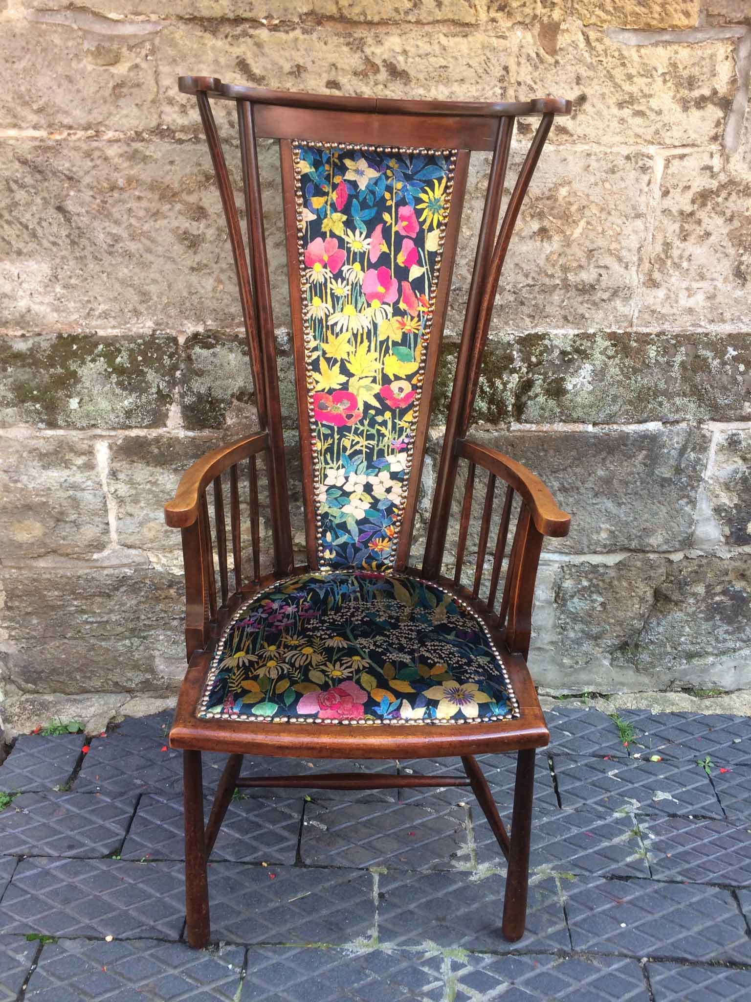 Arts and crafts high back chair upholstered in faria flowers velvet by liberty