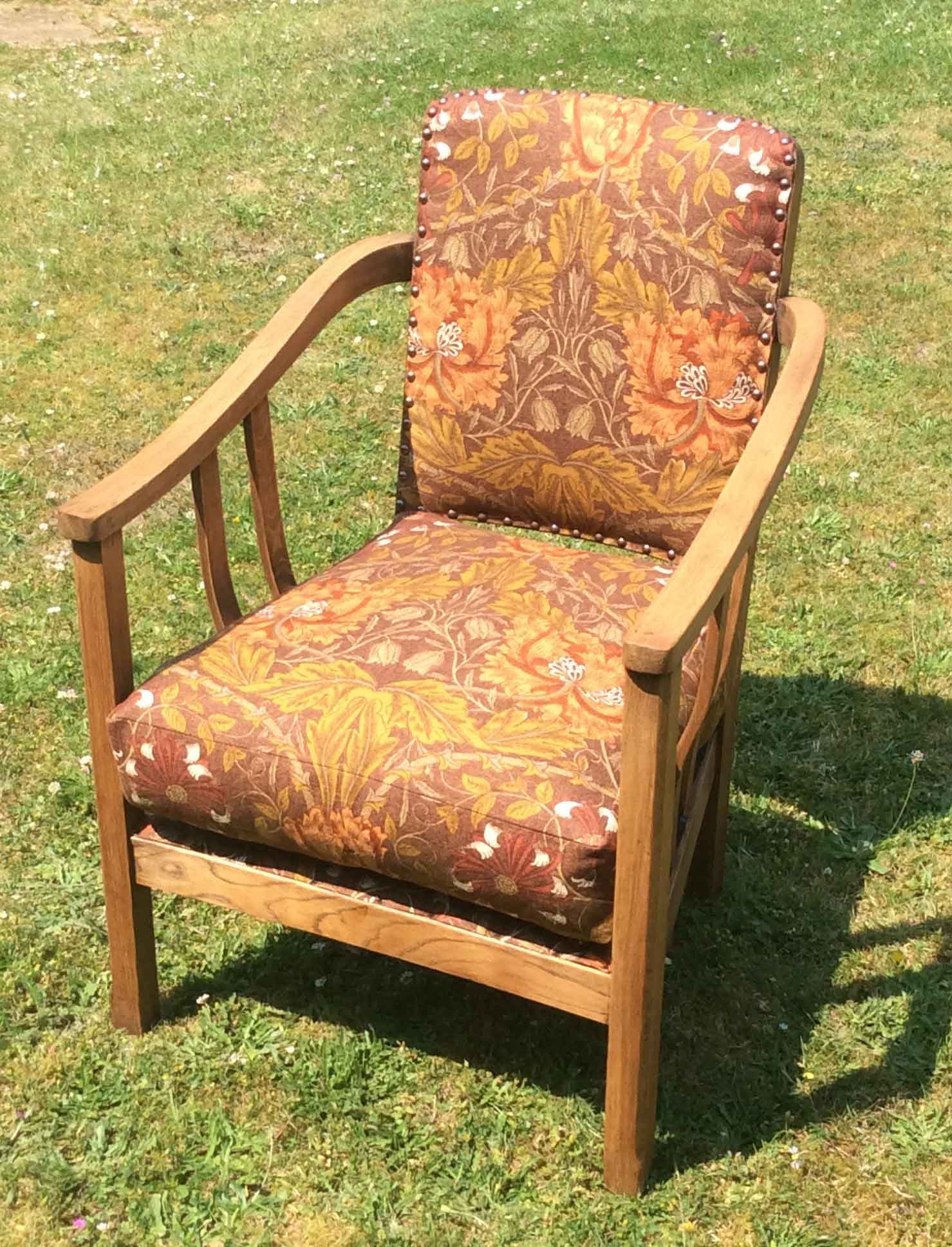 Arts and crafts style oak chair upholstered in honeysuckle by William Morris