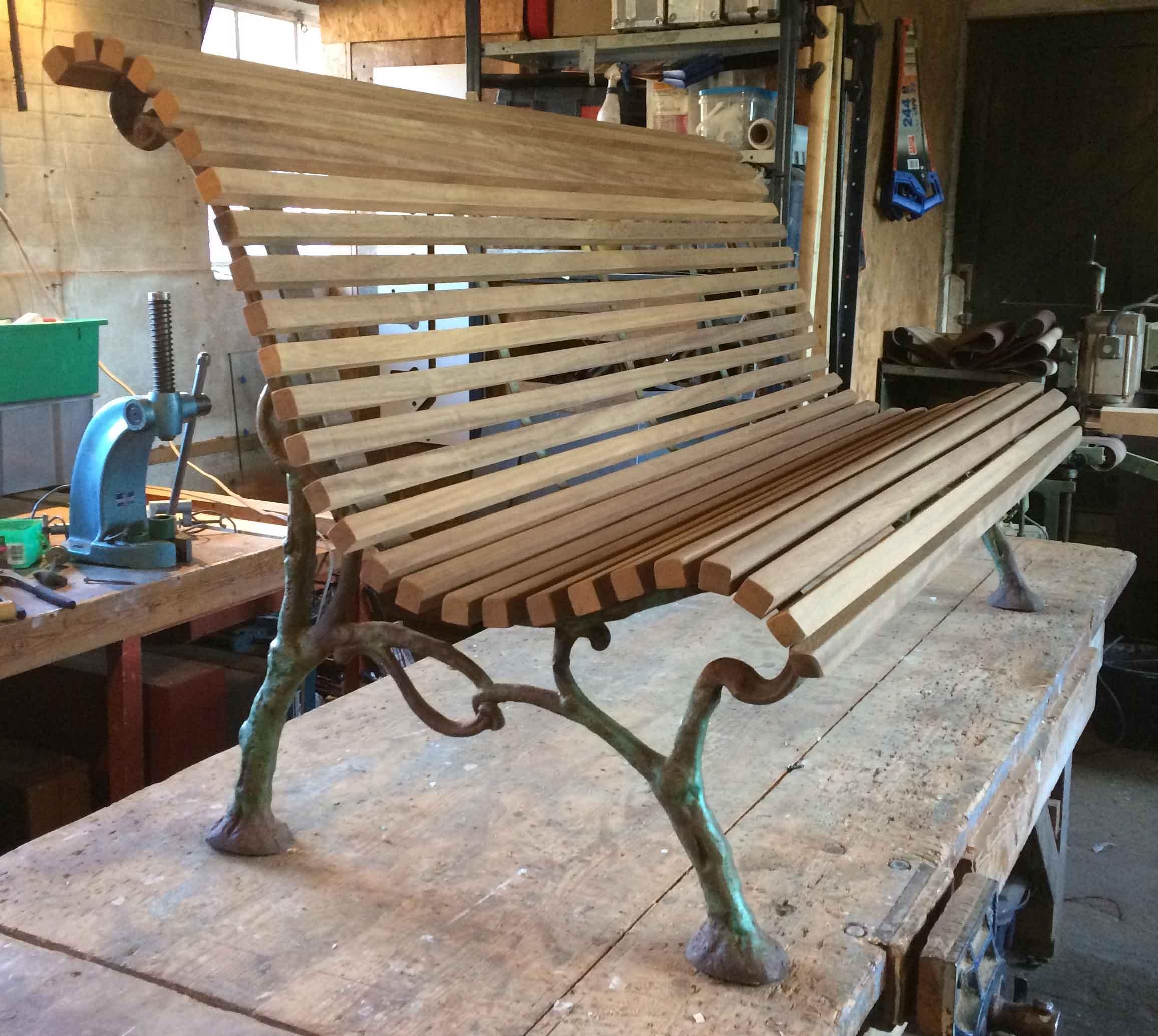 Art nouveau cast iron bench ends with oak stretchers