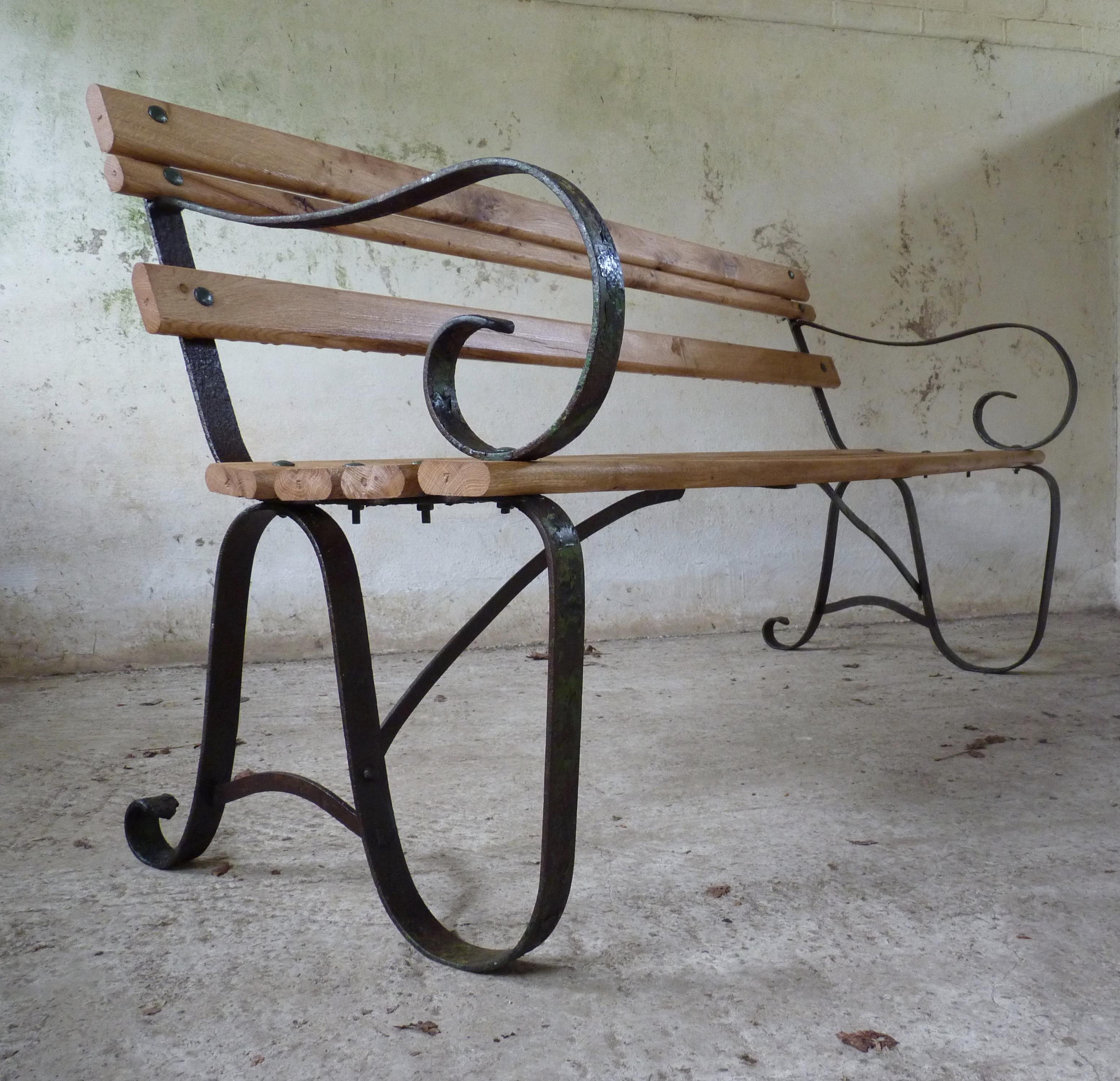 antique wrought iron and oak garden bench