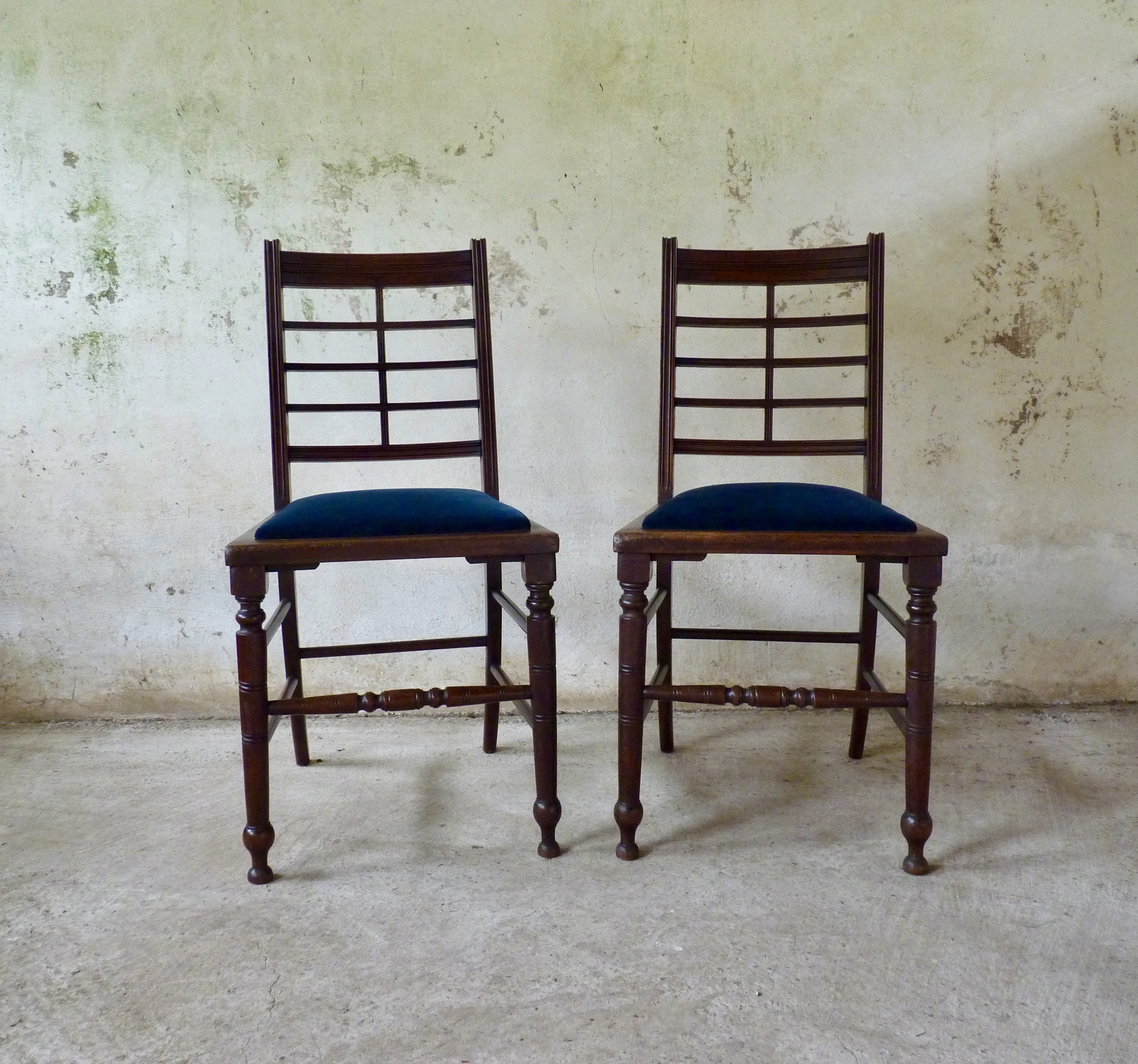 Pair of aesthetic movement walnut chairs