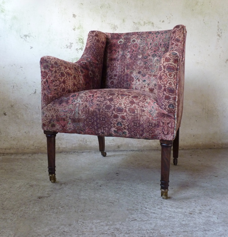 Edwardian armchair on tall turned legs
