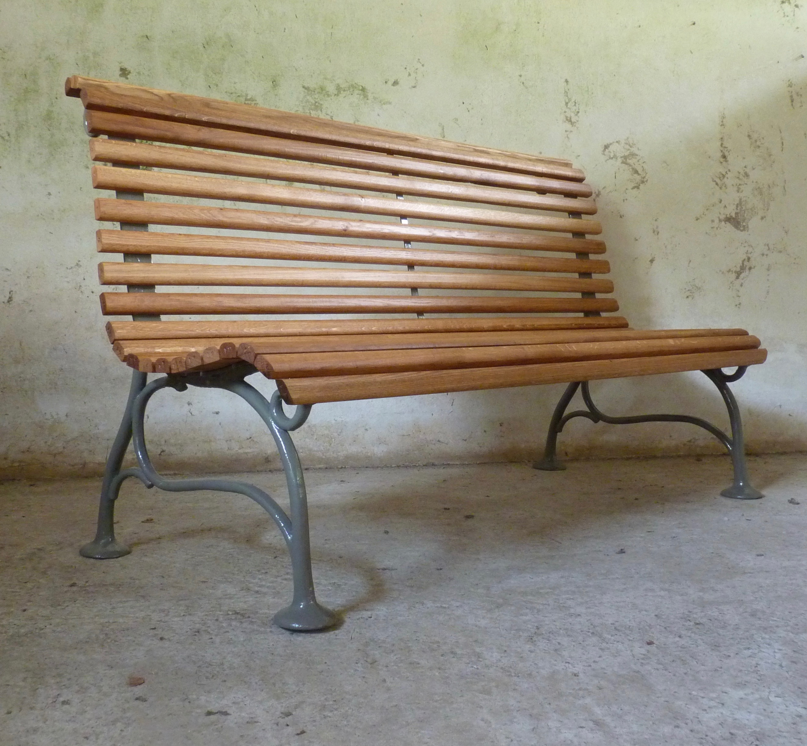 cast iron and oak scrolled bench