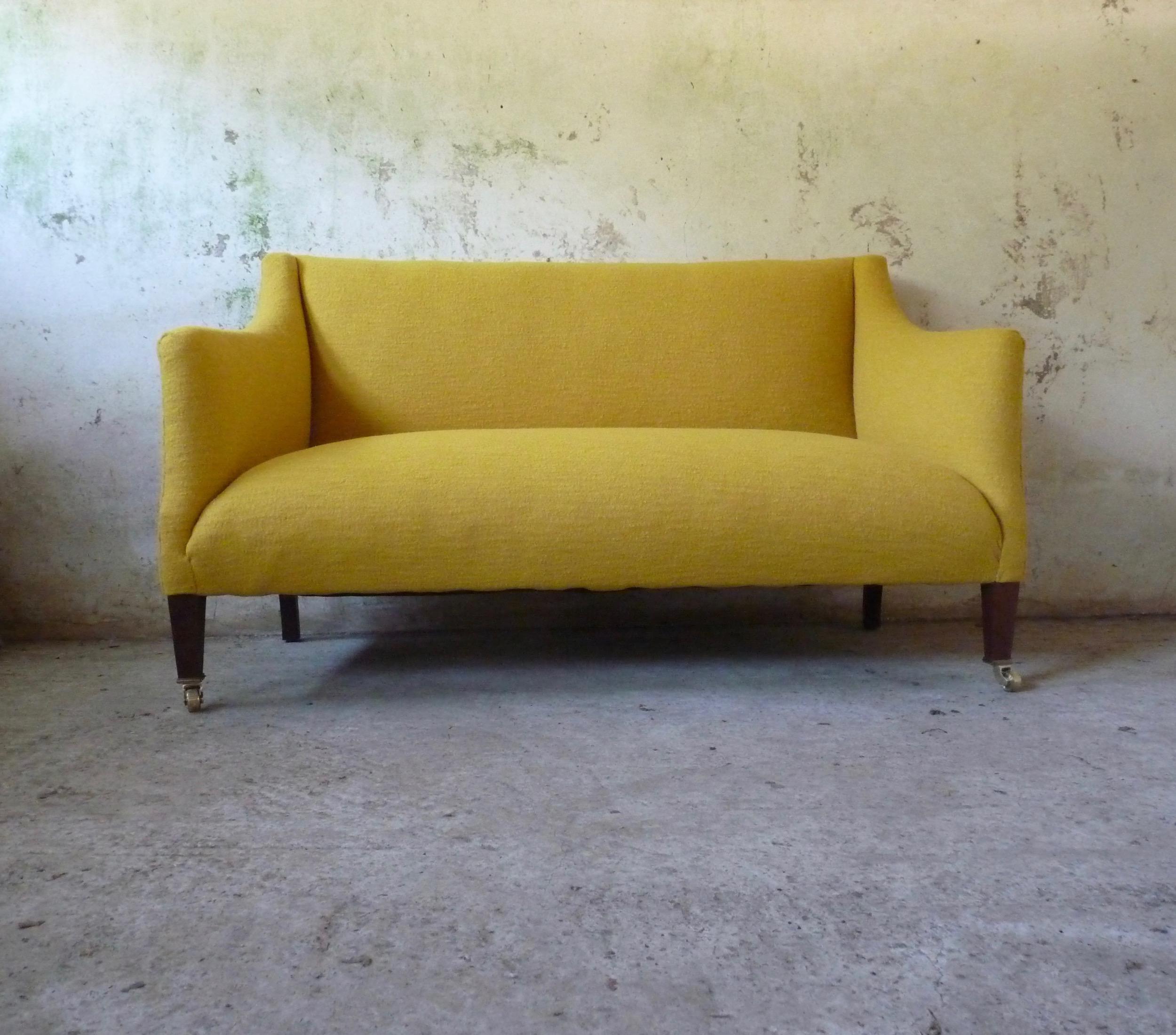 Edwardian settee upholstered in wool