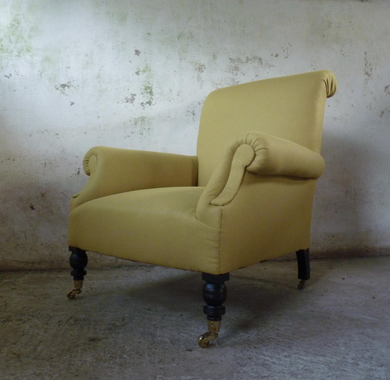 early twentieth century scrolled back easy armchair