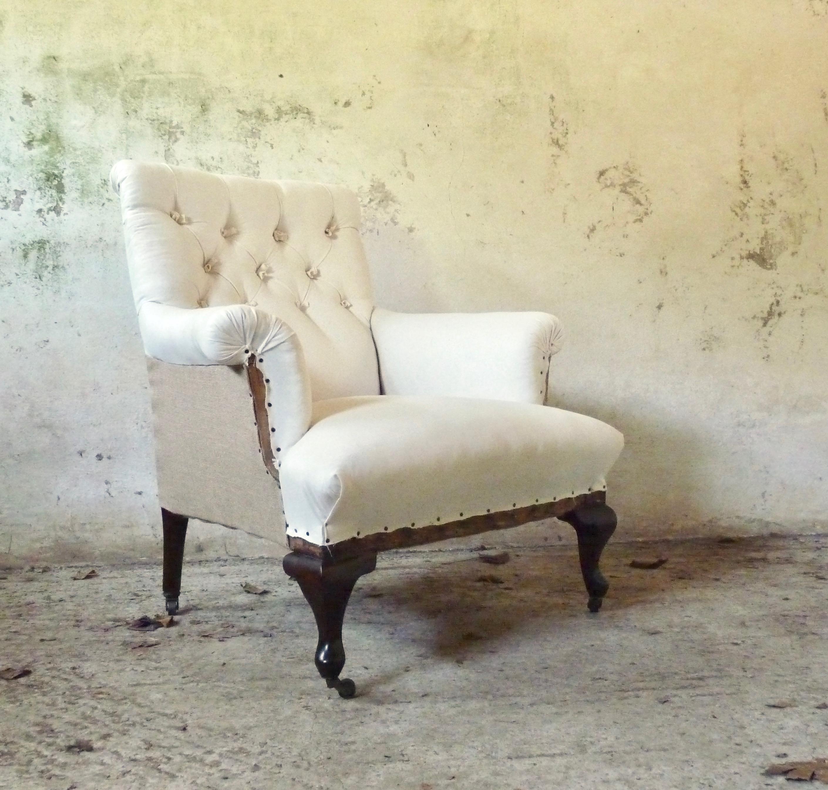 button backed elegant armchair