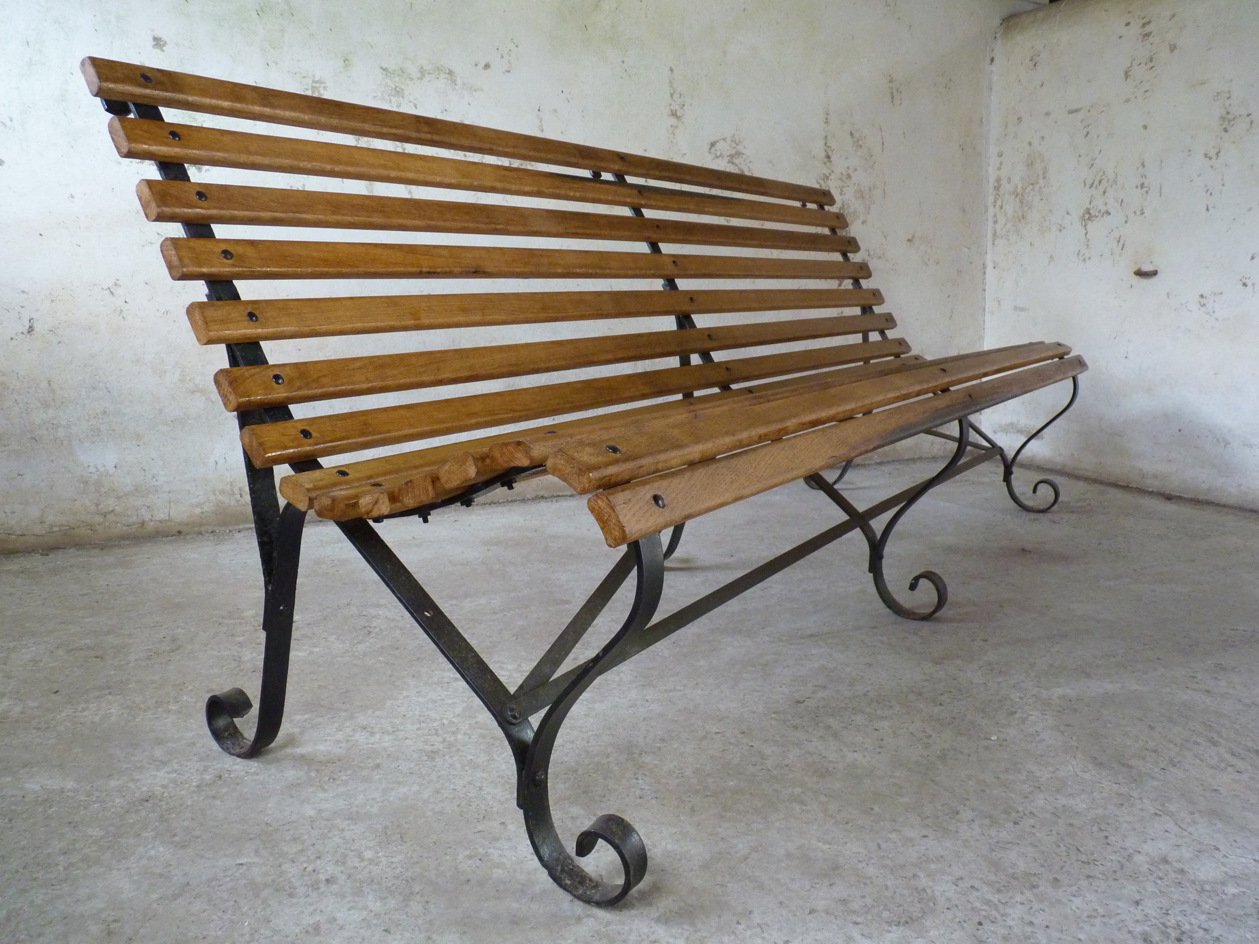 antique wrought iron and oak bench
