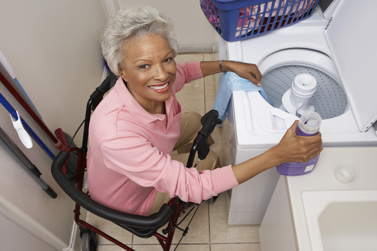 disabled woman doing laundry