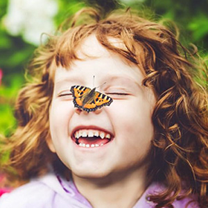 Photo of a butterfly on a girl's face