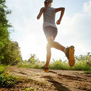 Photo of a woman jogging on trails