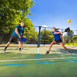 Photo of a couple playing pickle ball