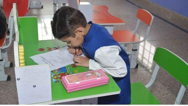 kid reading at nimt school avantika ghaziabad