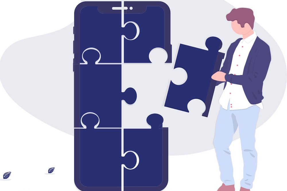 guy putting a puzzle piece of an app together