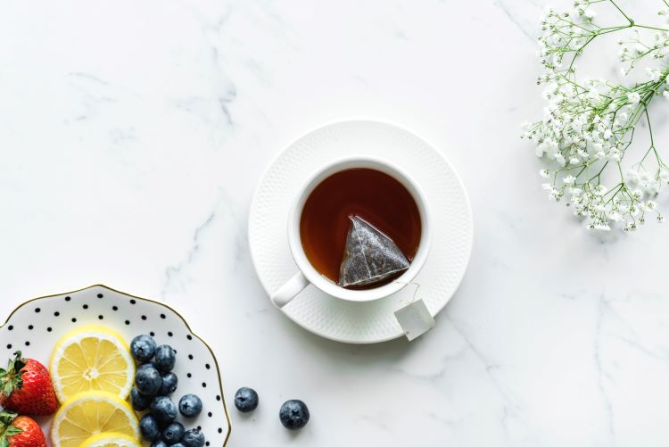 afternoon tea catering ideas - cup of tea with a platter of fruit