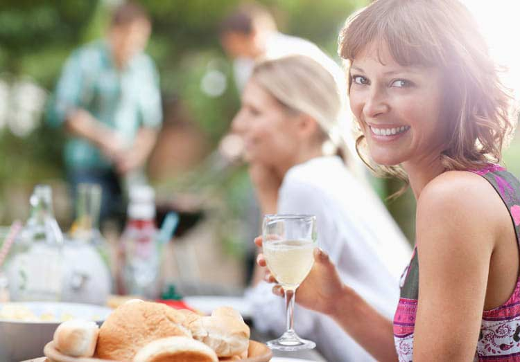 corporate bbq event woman with drink