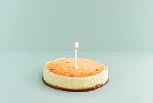 celebration foodiz - cheese cake with a candle in the middle