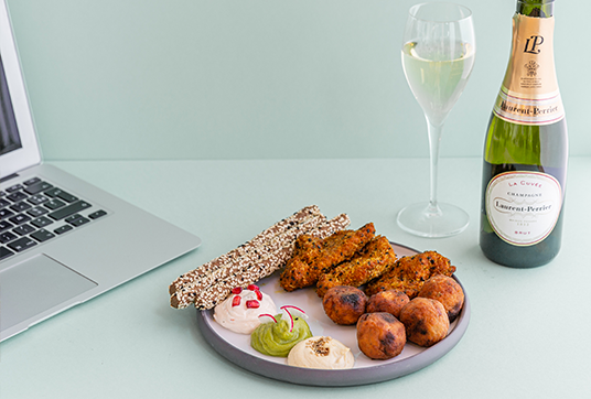 Picture with a bottle of Laurent Perrier and a plate of salty finger food